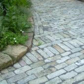 Perfectly laid bluestone cobblestone brick for a driveway.
