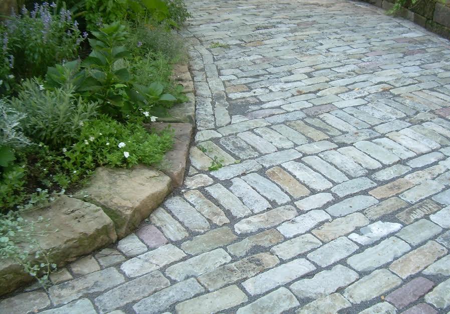 Perfectly laid bluestone cobblestone brick for a driveway.