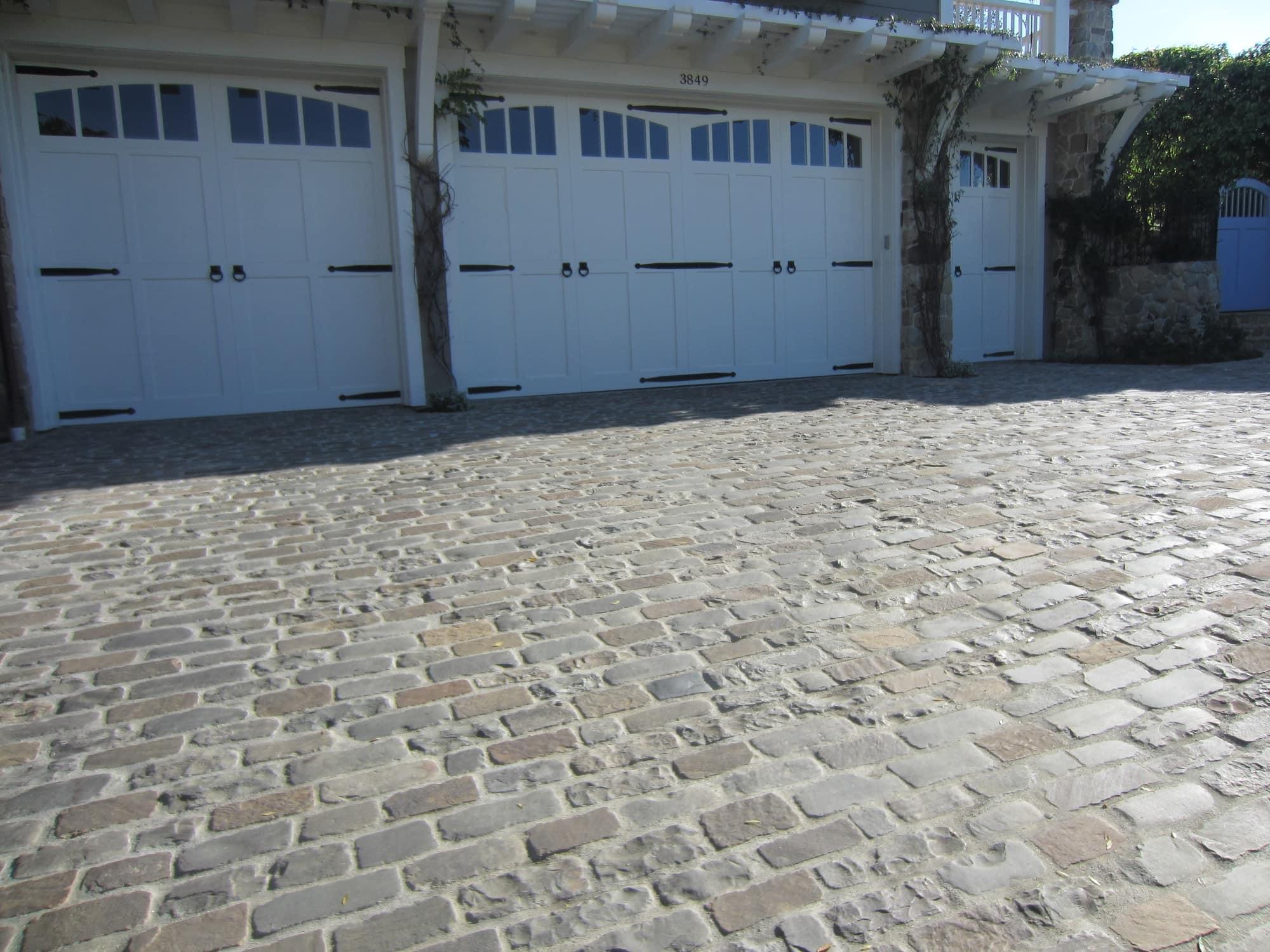 3 car garage driveway built with bluestone cobblestone brick.