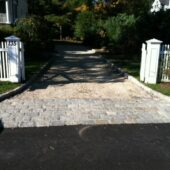 Perfectly laid out driveway built with European Blend Cobblestone brick.