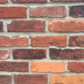 Narrow show of a mixed reds brick wall from historical bricks. Built in a Warehouse in New York.