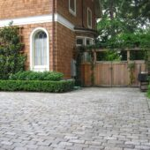 You can view the corner of the front area of a house that is paved with Salt and Pepper Cobblestone.
