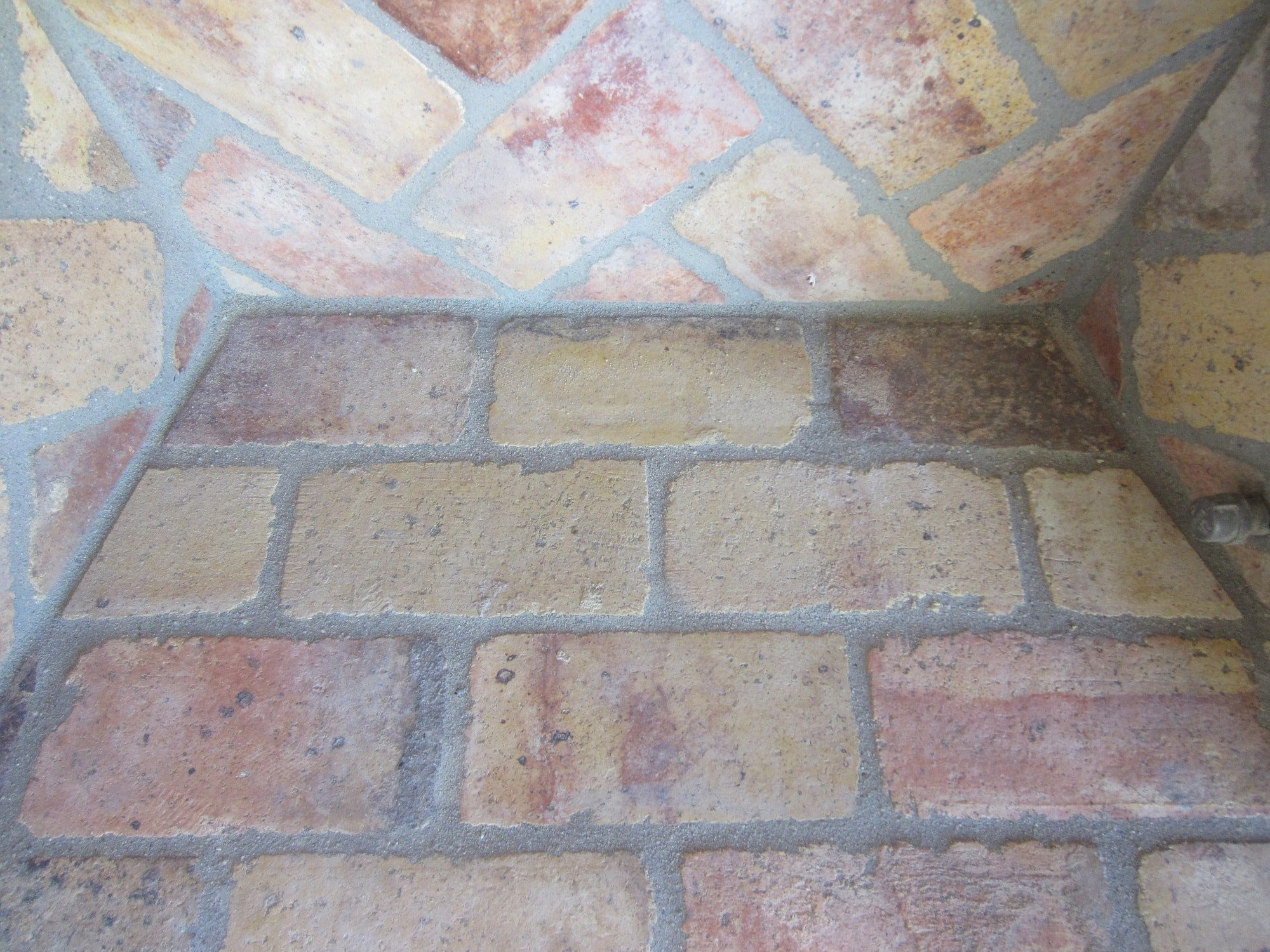 Close-up photo of the top of the interior of a Reclaimed Antique Firebrick chimney.