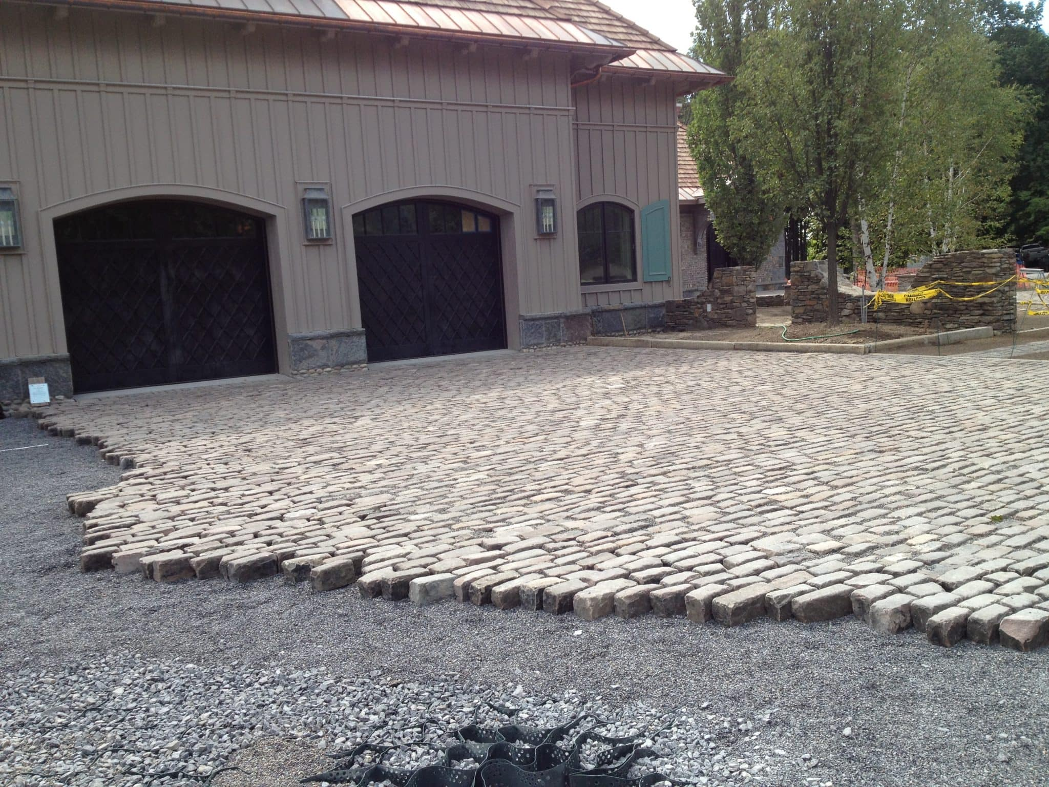 You can see a warehouse type of structure with an Old English Cobblestone paved street in-front.