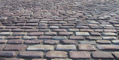 Close-up view of an Old English Cobblestone paved ground.