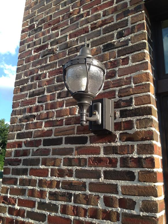 Tudor Clinkers wall with a lamp.