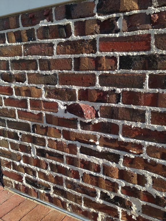 Close-up view of a tudor clinker wall. You can view the different colors.