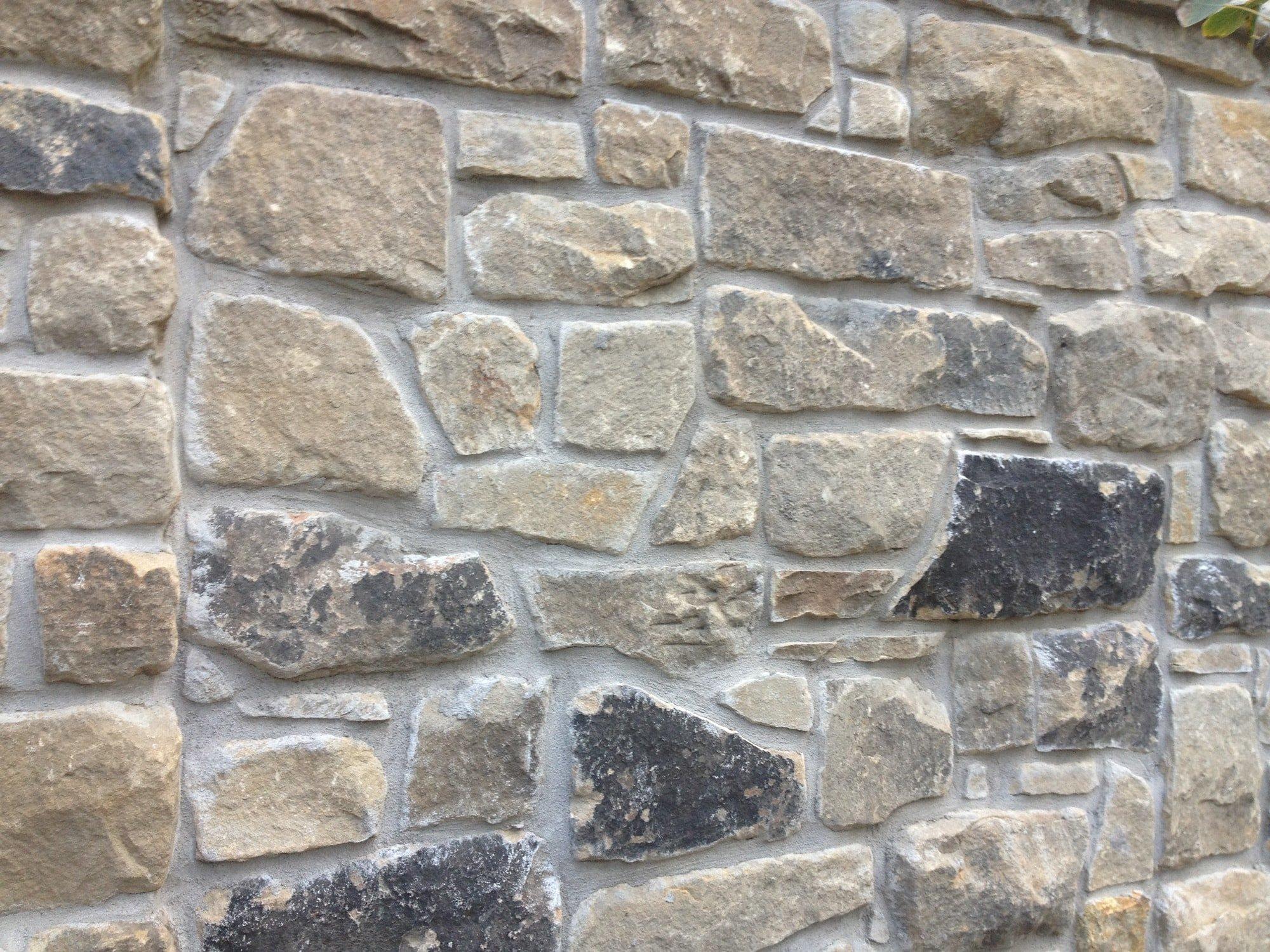 Close-up view of a Bluestone Cobblestone wall.