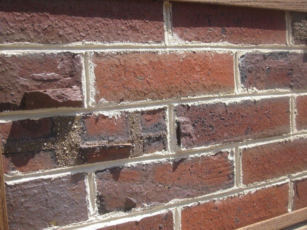 Close-up of an Old Pasadena Clinker brick wall taken at an angle.
