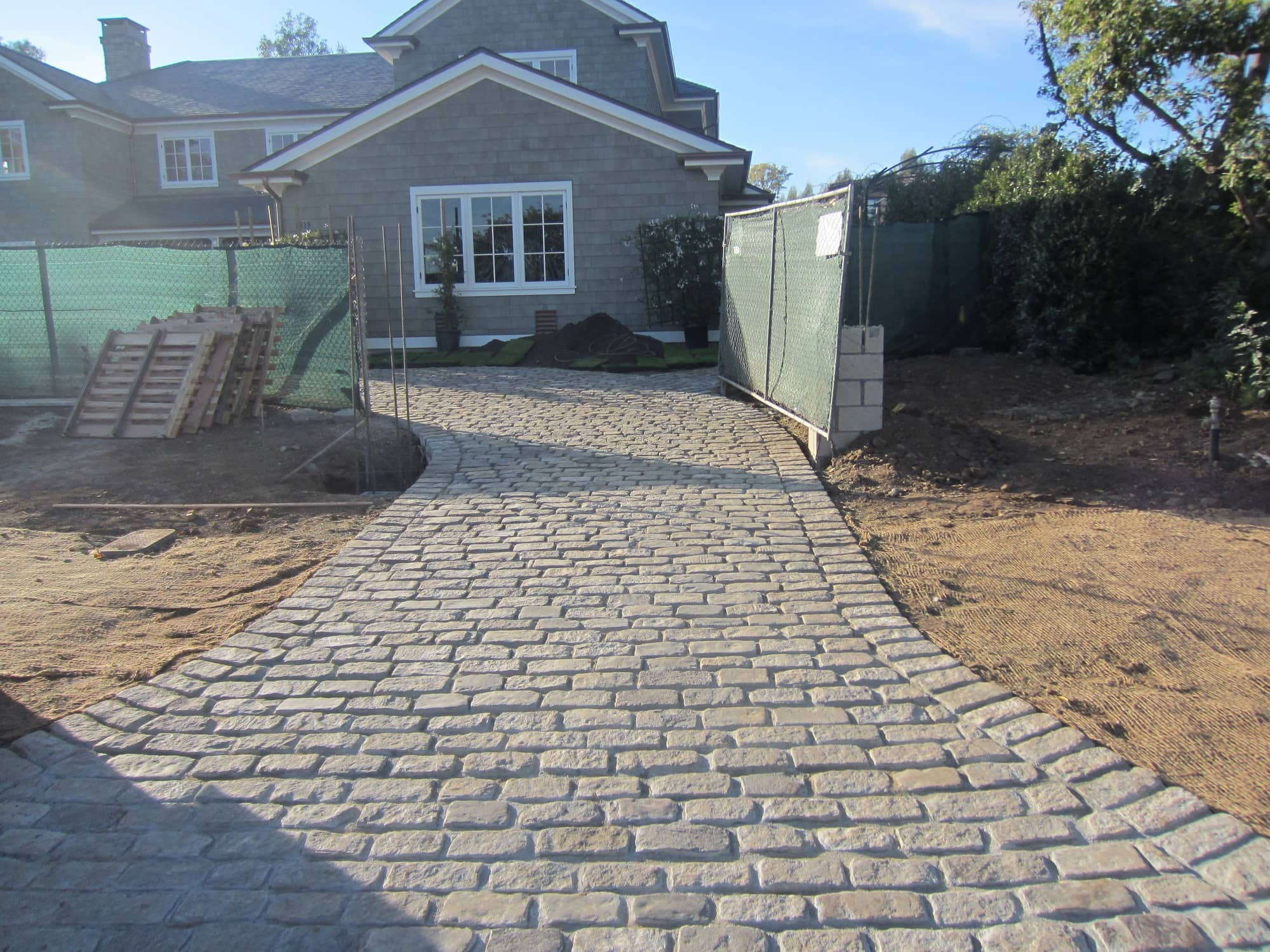 You can view the driveway entrance, paved with Salt and Pepper Cobblestone. It's a big beautiful house with an equally beautiful driveway.