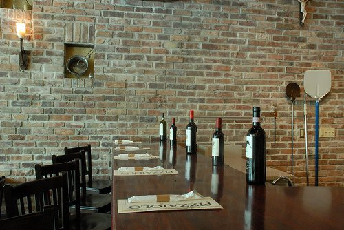 Interior of an upclass restaurant built with old tuscany brick for the interior walls.