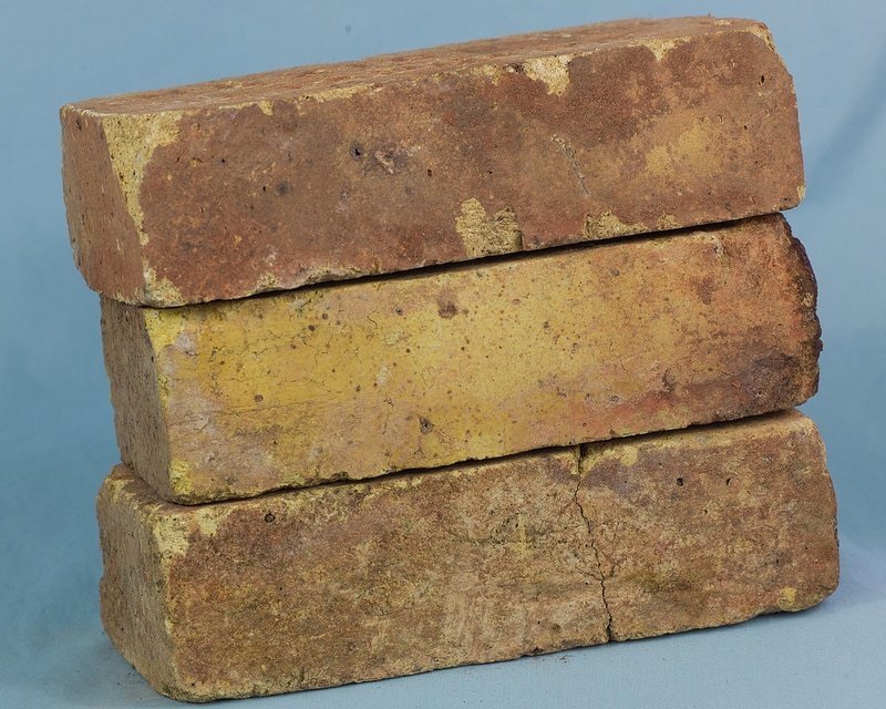 Reclaimed Antique Firebrick individual bricks. You can see the details and texture of each brick.