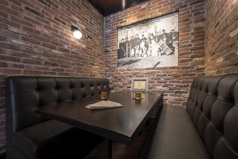 You can see a restaurant booth with Veneer brick in the interior walls.