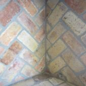 Close-up photo of the corner of the interior of a Reclaimed Antique Firebrick chimney.