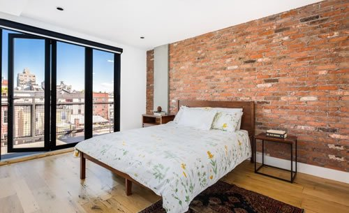 Bedroom of an Antique Warehouse Red Brick Veneer.