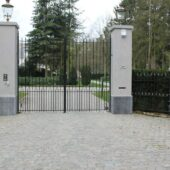 You can view a gated entrance with Antique European Porphyry Cobbles paving.