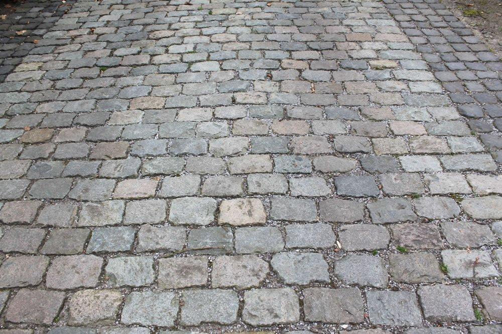 Close up view of Antique European Porphyry Cobbles paving.