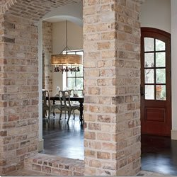 You can view a pillar in the middle of an arcade inside a house. The arcade is built out of veneer brick.