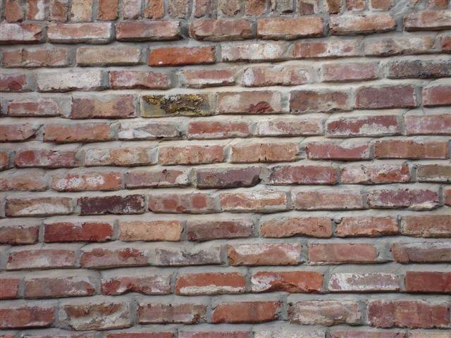 Close up view of an old tuscany brick wall.