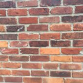 Wide shot of a mixed reds brick wall in a different pattern from historical bricks. Built in a Warehouse in New York.