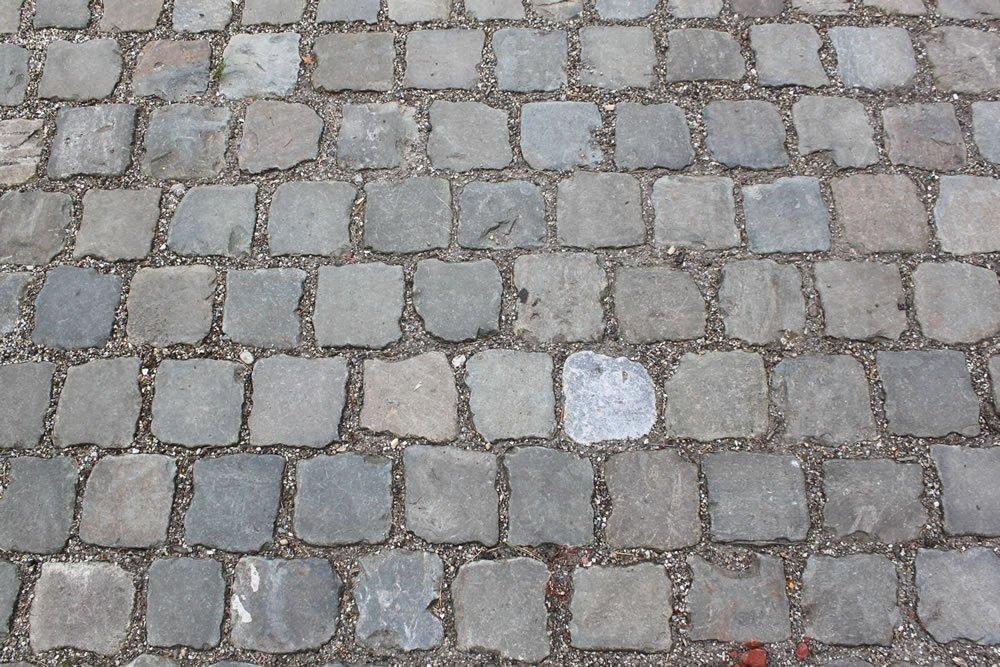 Close-up photo of Antique European Sandstone Cobbles paving.
