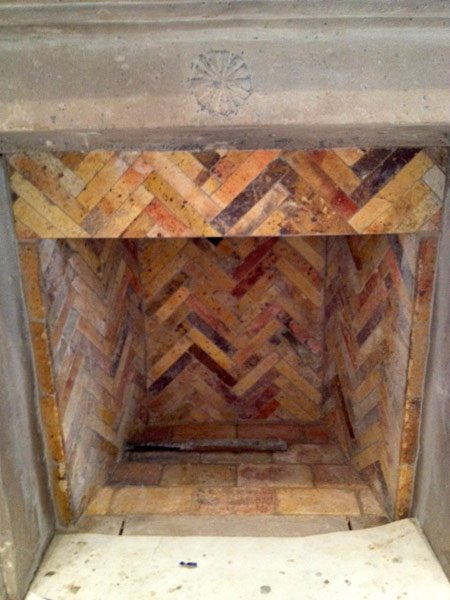 You can view the interior of a clean Reclaimed Antique Firebrick built chimney.