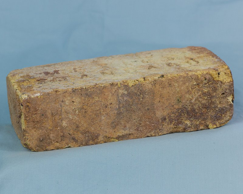 Individual Reclaimed Antique Firebrick. You can see the texture and different shades of color in this brick.