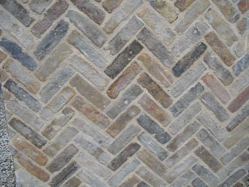 close up of chevron pattern using reclaimed buff building bricks