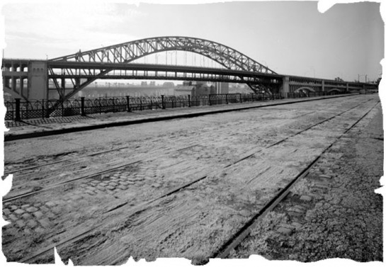 Old image of a Cleaveland bridge with an old cobblestone street paved with Belgian Blocks And Stone Pavers