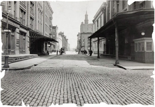 Old image of a street paved with antique cobblestones