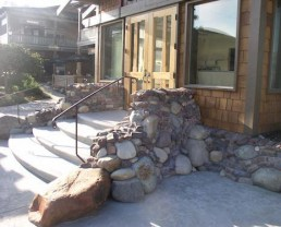 Beautiful porch area built with Extreme Radical Clinkers. You can see the rocks at the side of the stairs that were used. it creates an amazing texture and nice features to the front of the house.
