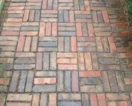 Floor built with Purington Skinny Pavers in a pattern where there are horizontal and vertical sections of with three bricks.