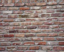 Close up photo of a wall built with Old Tuscany Bricks
